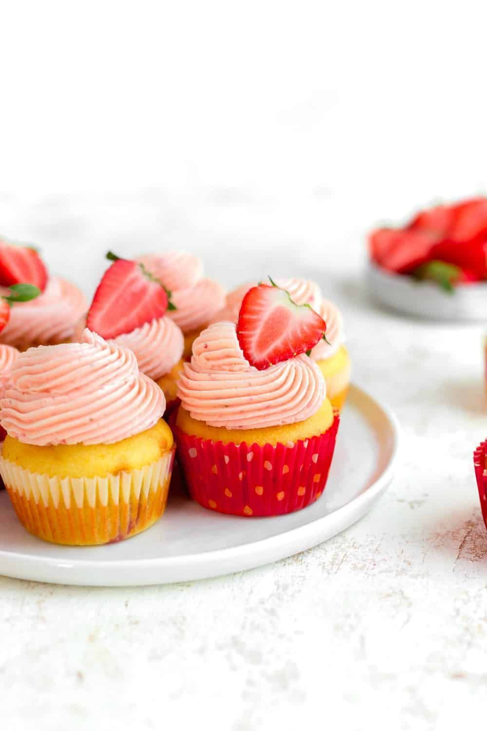 Easy Strawberry Cupcakes use a simple method for doctoring cake mix. Top them wi...