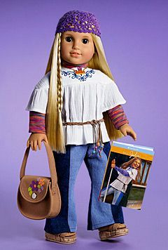 This is the American girl doll Julie 1974 *brown eyes, long blonde hair with thi...